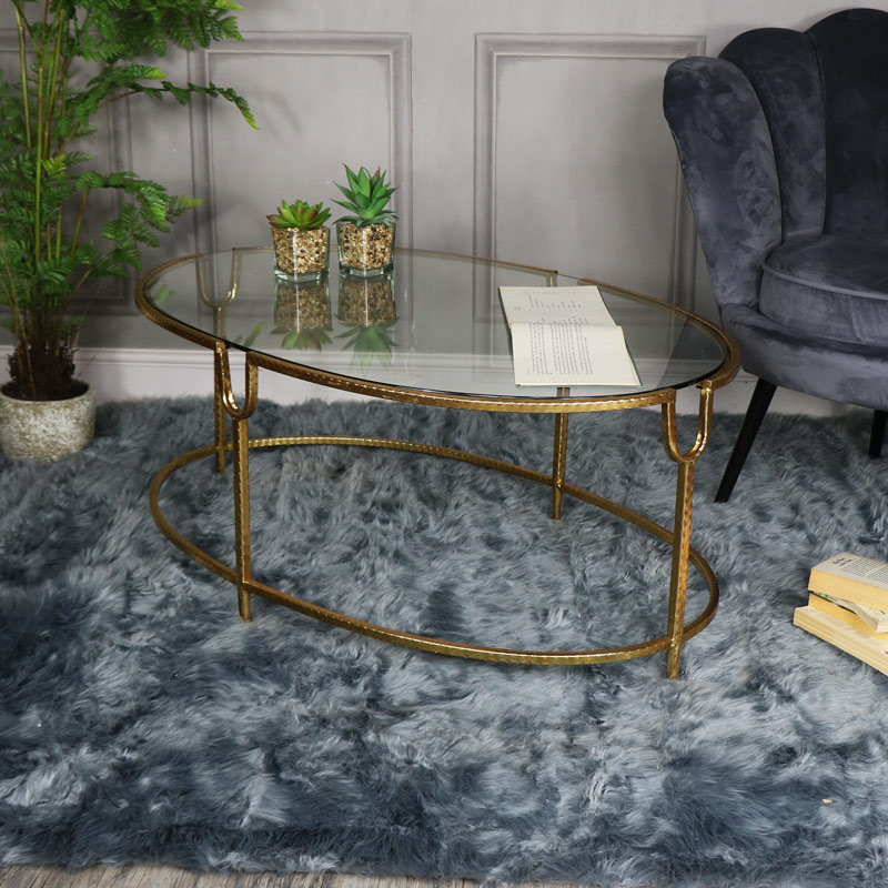 Large Gold Oval Glass Topped Coffee Table